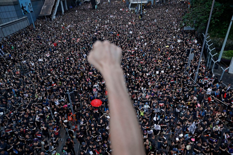 HONG KONG   Demonstrators flood the streets on June 16 to protest an extradition bill that would allow suspects to be sent for trials in mainland China, which many saw as infringing on Hong Kong's judicial freedoms. Vincent Yu/AP