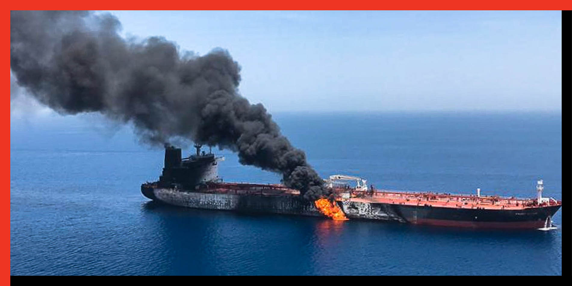A picture obtained from Iranian News Agency ISNA on June 13, reportedly shows fire and smoke billowing from an oil tanker said to have been attacked in the waters of the Gulf of Oman. The attack on two tankers came amid spiralling tensions between Tehran and Washington, which has pointed the finger at Iran over earlier tanker attacks.