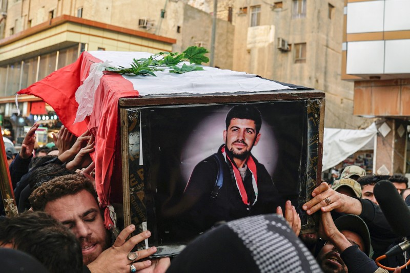 Mourners carry the coffin of a demonstrator killed during protests in Najaf, Iraq, on Dec. 7.