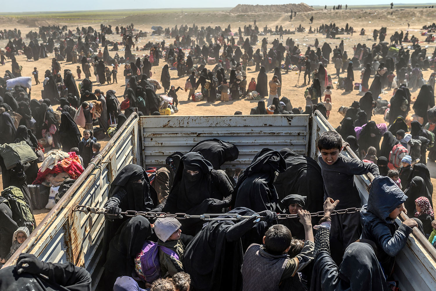 Evacuees from Baghouz arrive at a screening area in the eastern Syrian province of Deir Ezzor on March 6. BULENT KILIC/AFP/Getty Images