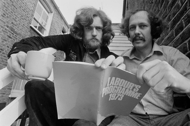 Jeremy Corbyn, left, with Les Silverstone, holds a copy of the Labour Party's Programme 1973, a radical social and political work drawn up by left-wing members of the Labour Party, in September 1975.