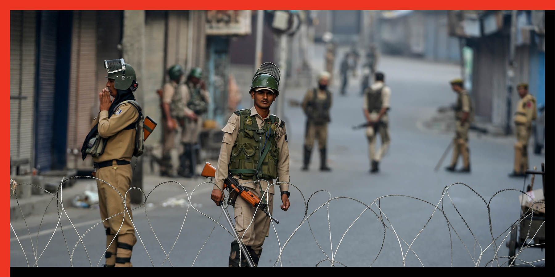Security personnel stand guard as they block a road during a lockdown at Maisuma locality of Srinagar on Sept. 27.