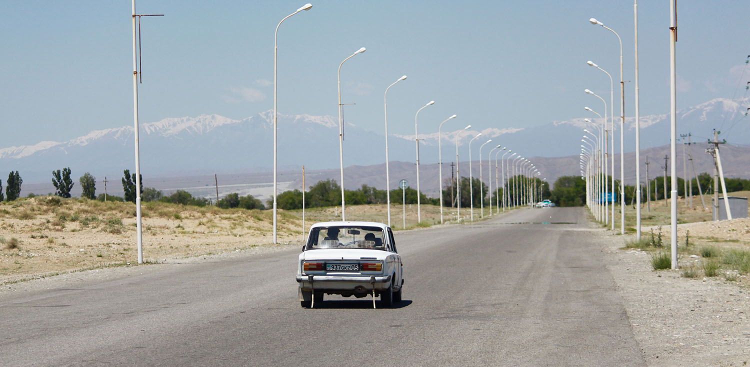 A car drives back into Kazakhstan from the Khorgos International Center of Boundary Cooperation, a joint Kazakh-Chinese area where merchants from both countries buy and sell goods, on May 29.