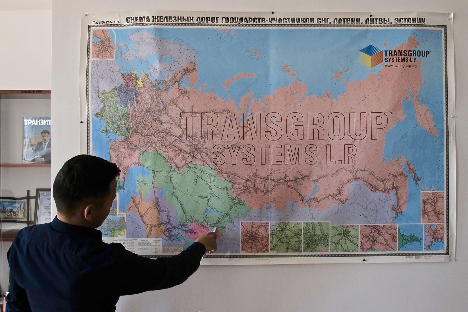 Nurlan Toganbayev, the director of commercial department at the Khorgos Gateway, points to a map of the sprawling railway lines that connect Asia to Europe on May 29.