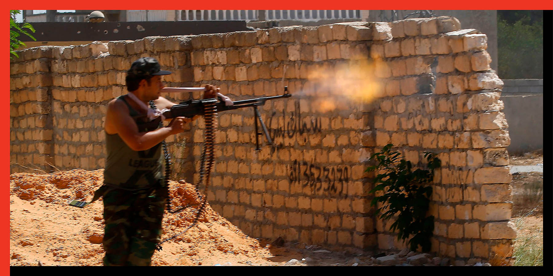 A fighter loyal to the Libyan Government of National Accord fires his gun during clashes with forces loyal to strongman Khalifa Haftar in the Tripoli suburb of Ain Zara on Sept. 7.