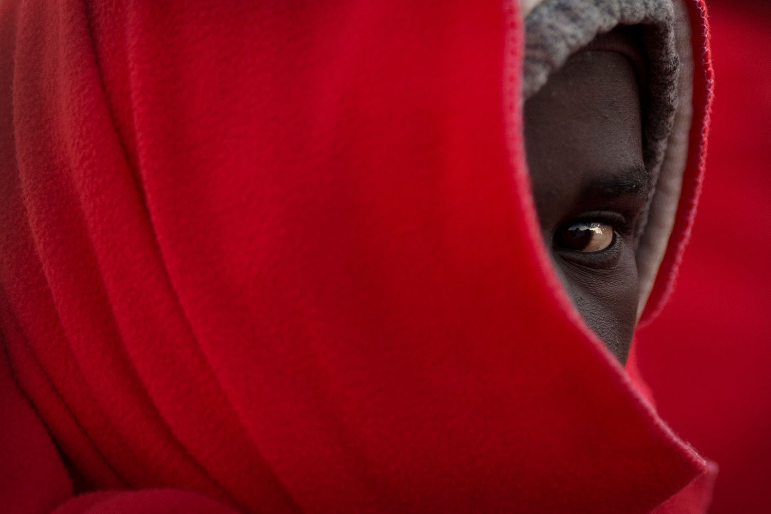 A migrant keeps warm with a Red Cross blanket upon arrival at the harbor of Malaga on Jan. 6 after an inflatable boat carrying 185 migrants was rescued by the Spanish coast guard off the Spanish coast. JORGE GUERRERO/AFP/Getty Images