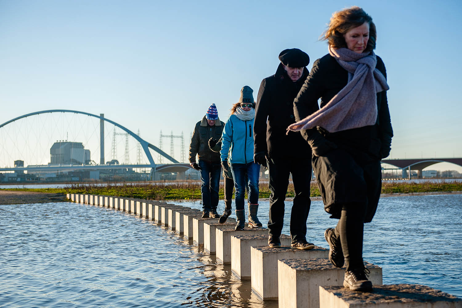 Residents walk in Nijmegen, one of the Dutch cities affected by flooding of the Rhine on Jan. 7, 2018.