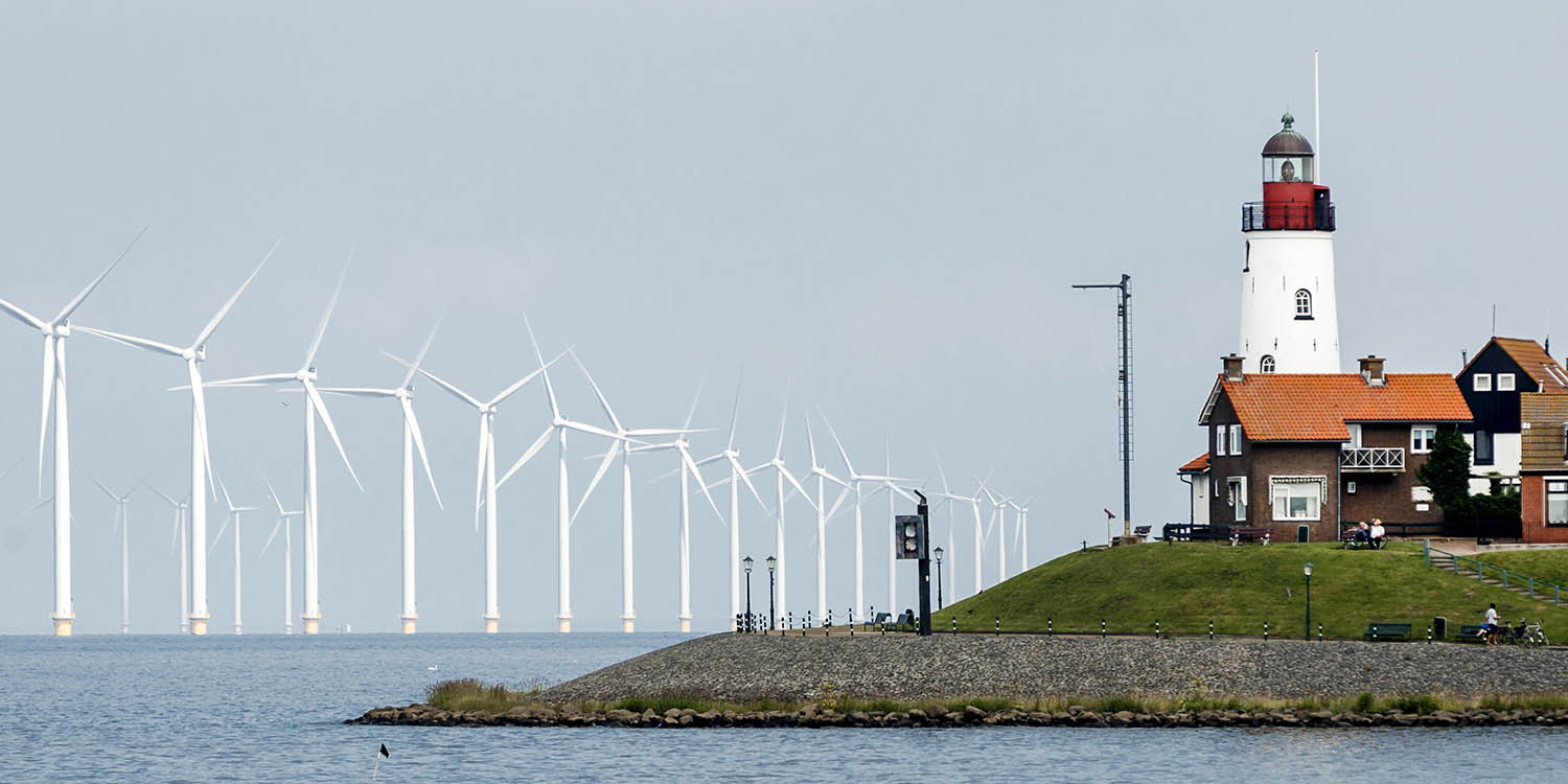 Windmills dot the horizon at the offshore wind farm in Urk, Netherlands, on June 21, 2016.