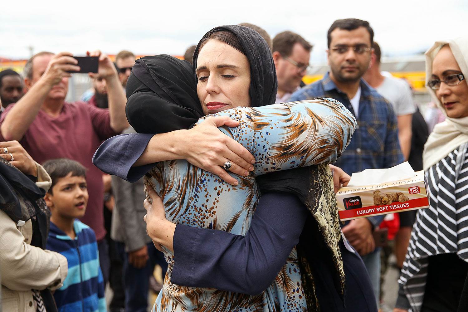 New Zealand Prime Minister Jacinda Ardern hugs a woman at the Kilbirnie Mosque in Wellington on March 17 in the wake of a mass shooting at a mosque that killed 51. Hagen Hopkins/Getty Images