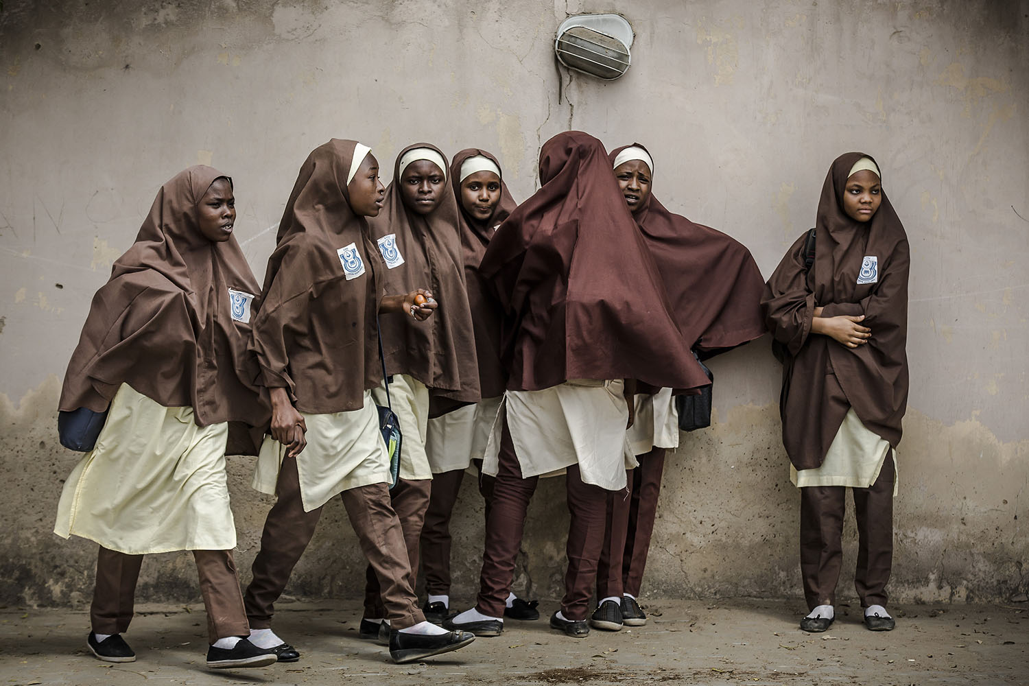 A group of girls leave their school during a rally by All Progressives Congress party supporters celebrating the re-election of the incumbent president and the leader of party in Kano, Nigeria, on Feb. 27. Luis Tato/AFP/Getty Images