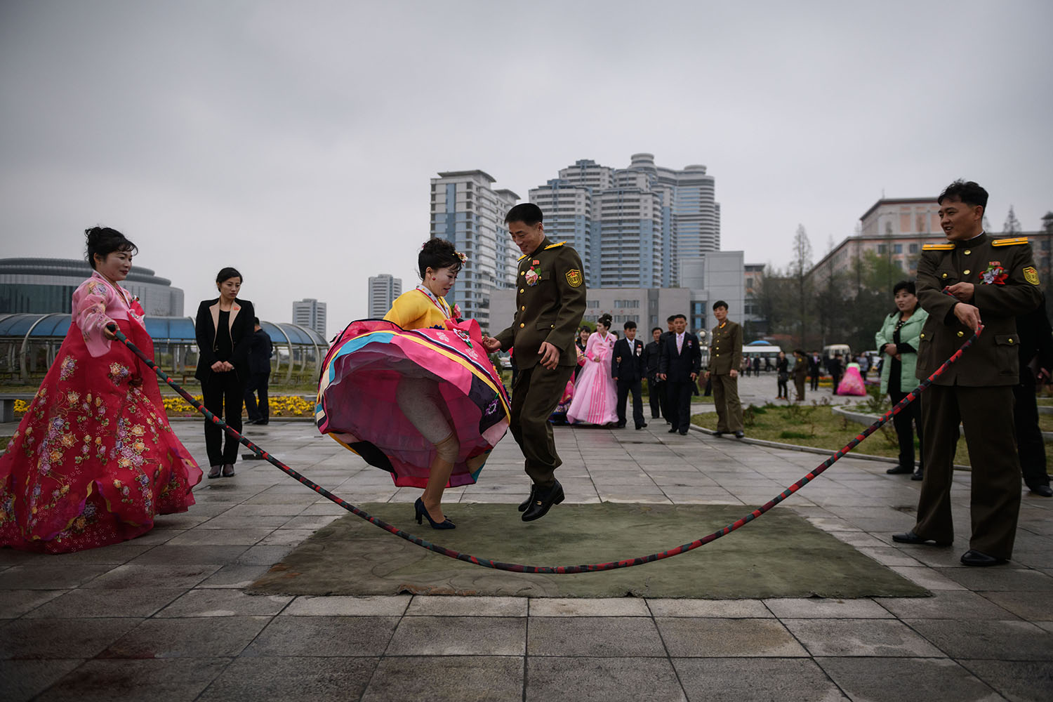 A bride and groom jump over a rope during a wedding photo shoot at a park in Pyongyang, North Korea, on April 18. Ed Jones/AFP/Getty Images