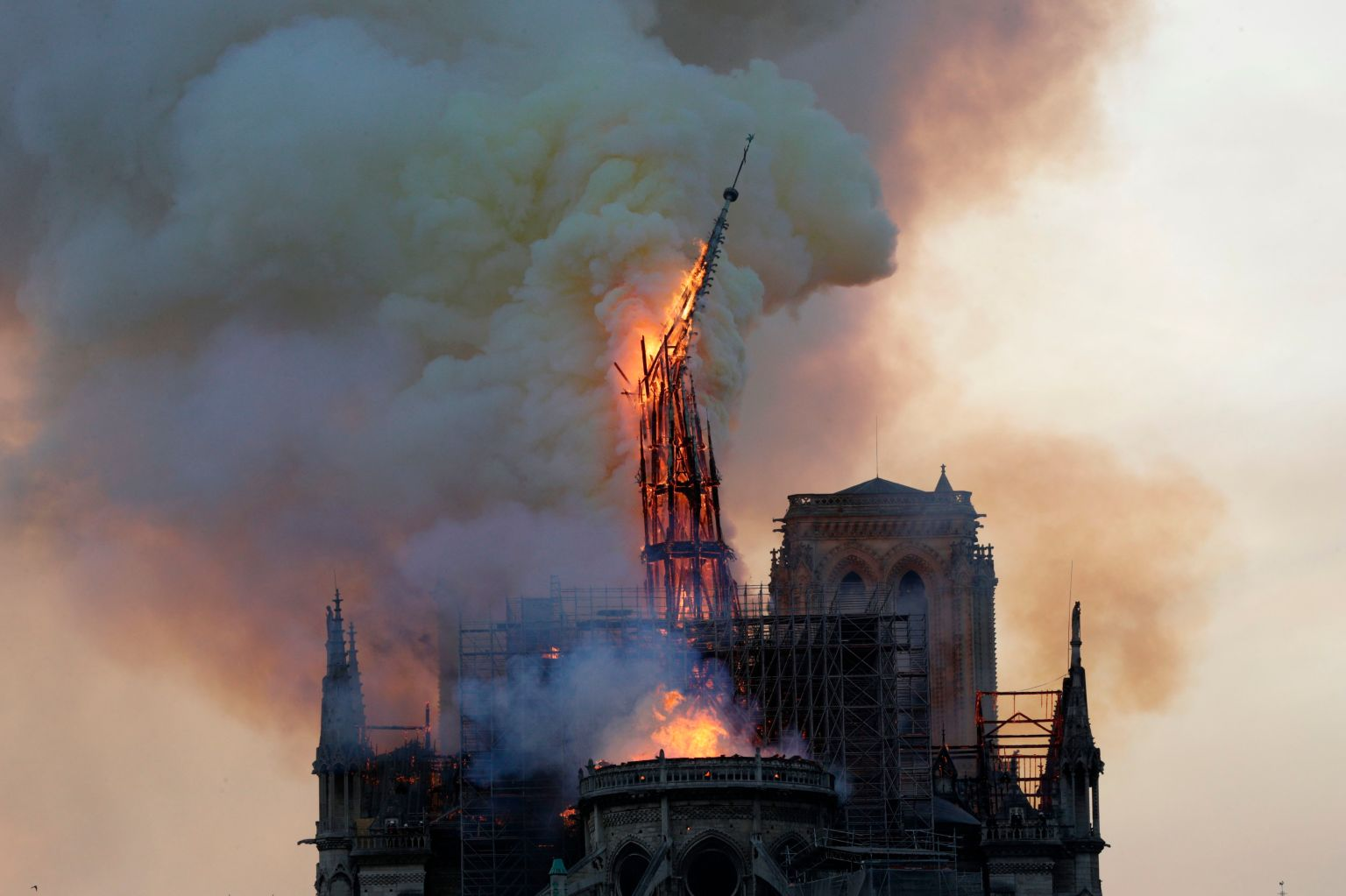 The spire of Notre Dame collapses as the cathedral is engulfed in flames in central Paris on April 15. GEOFFROY VAN DER HASSELT/AFP/Getty Images