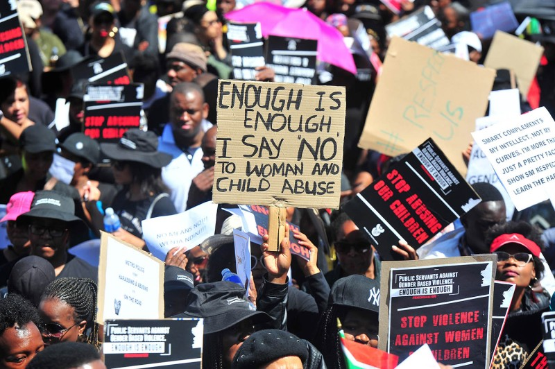 Men and women join in a protest march in Pretoria, South Africa