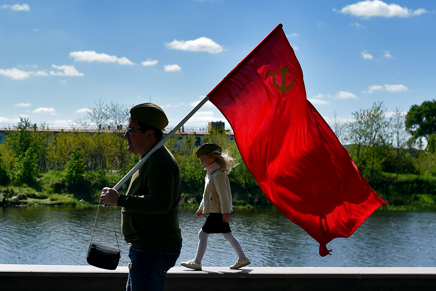 A man carries a Soviet flag during Victory Day celebrations in the town of Pinsk, southwest of Minsk, Belarus, on May 9. SERGEI GAPON/AFP/Getty Images