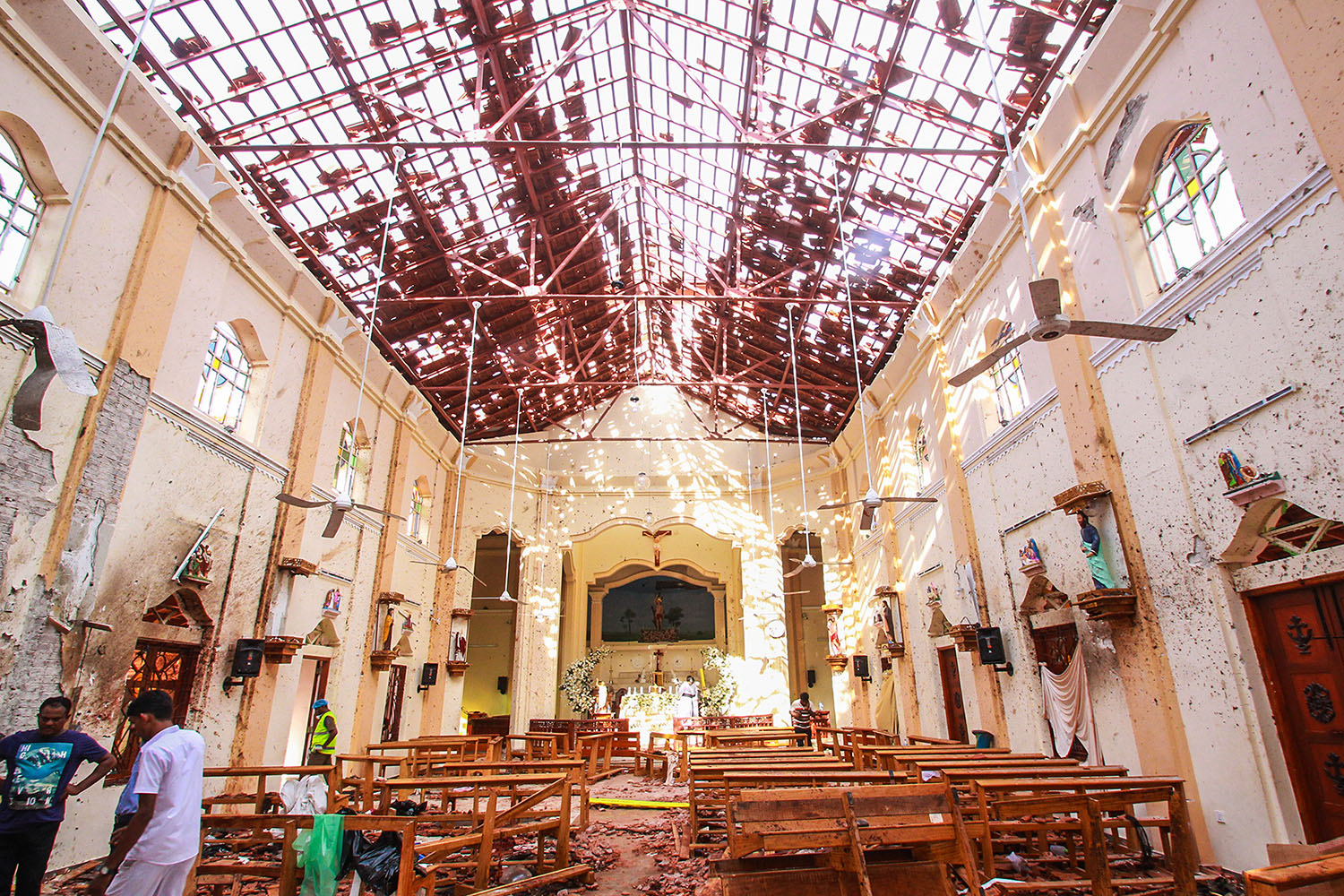 Sri Lankan officials inspect St. Sebastian's Church in Negombo, north of Colombo, after multiple explosions targeted churches and hotels across Sri Lanka on April 21. Stringer/Getty Images