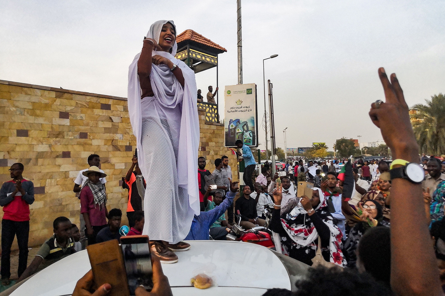 SUDAN | Alaa Salah, a Sudanese woman who propelled to fame after clips went viral of her leading chants against President Omar al-Bashir, addresses protesters during a demonstration in front of the military headquarters in the capital Khartoum on April 10. -/AFP/Getty Images