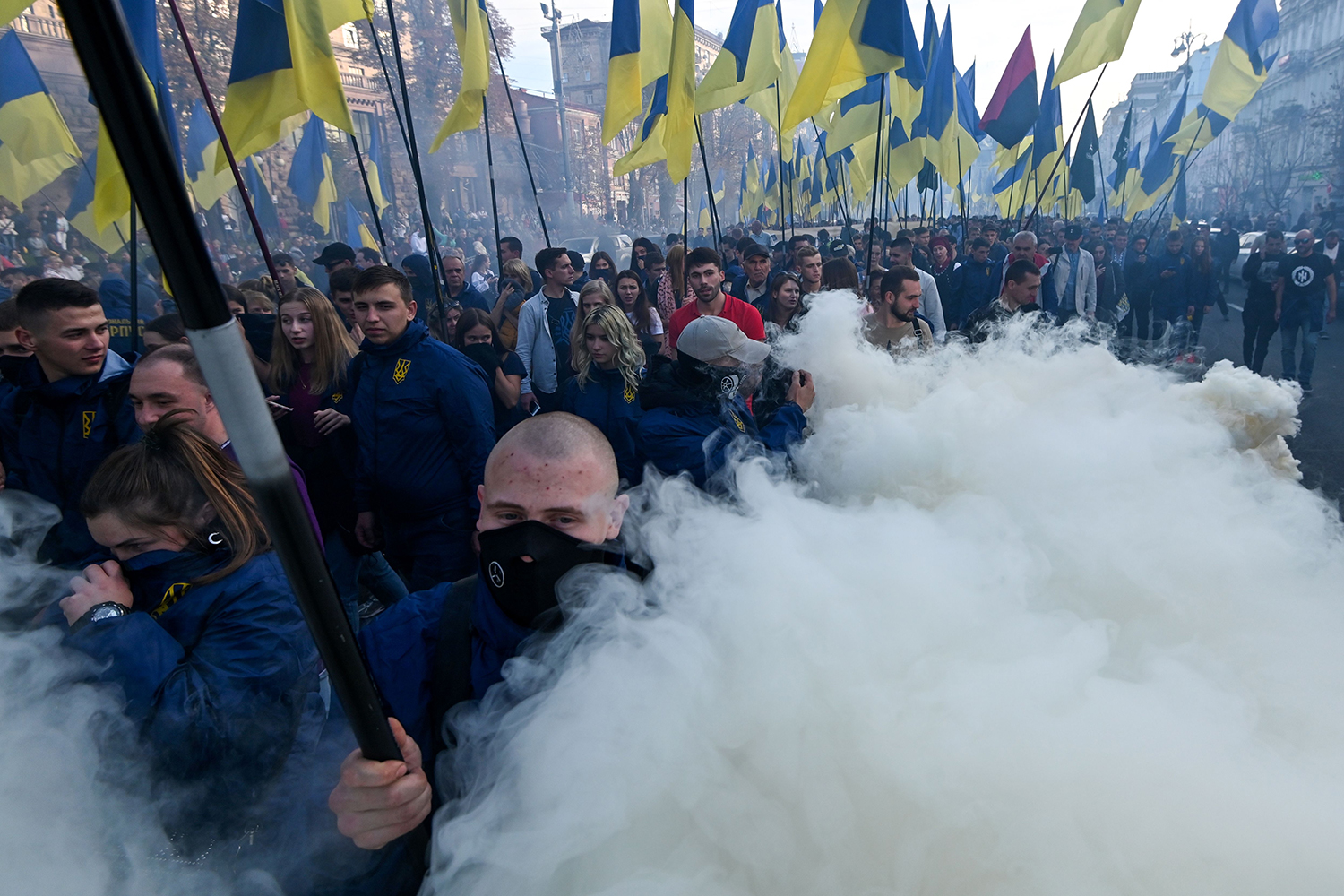 "UKRAINE | Activists and supporters of nationalist forces march in downtown Kyiv on Oct. 14. Thousands marched to decry the ""capitulation"" of a mooted pullback of troops fighting Moscow-backed separatists in the east and calling for victory in the five-year war. GENYA SAVILOV/AFP via Getty Images"