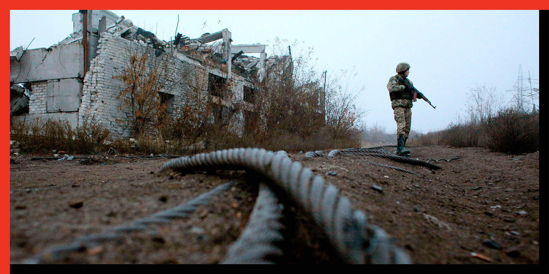 A Ukrainian serviceman patrols along the front line with Russia-backed separatists not far from the town of Avdiivka, Donetsk region, on Nov. 7.