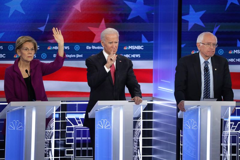ATLANTA, GEORGIA - NOVEMBER 20: Sen. Elizabeth Warren (D-MA)  (L), former Vice President Joe Biden and Sen. Bernie Sanders (I-VT) (R) participate in the Democratic Presidential Debate at Tyler Perry Studios November 20, 2019 in Atlanta, Georgia. Ten Democratic presidential hopefuls were chosen from the larger field of candidates to participate in the debate hosted by MSNBC and The Washington Post.  (Photo by Alex Wong/Getty Images)