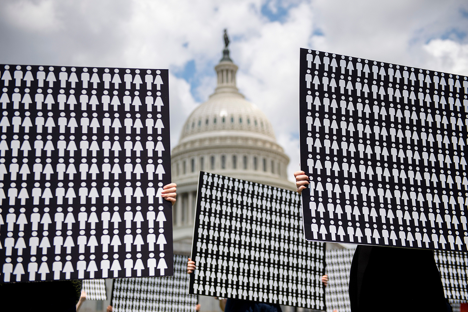 UNITED STATES | Demonstrators hold up placards representing the number of the people who have died due to gun violence during a protest on Capitol Hill in Washington on June 20. JIM WATSON/AFP via Getty Images