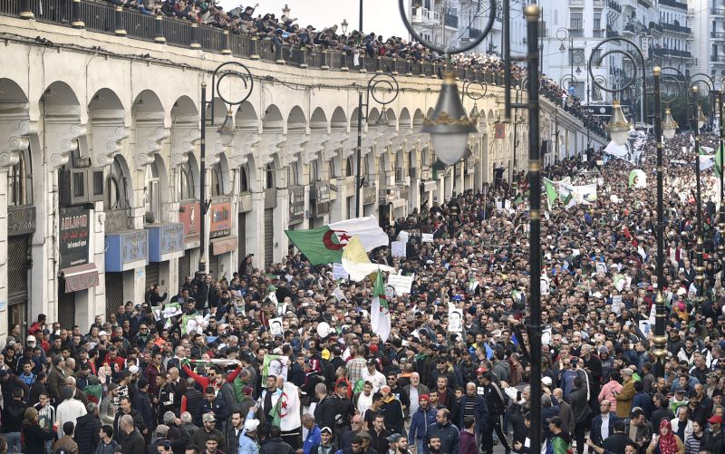 Algerian protesters take part in an anti-government demonstration.