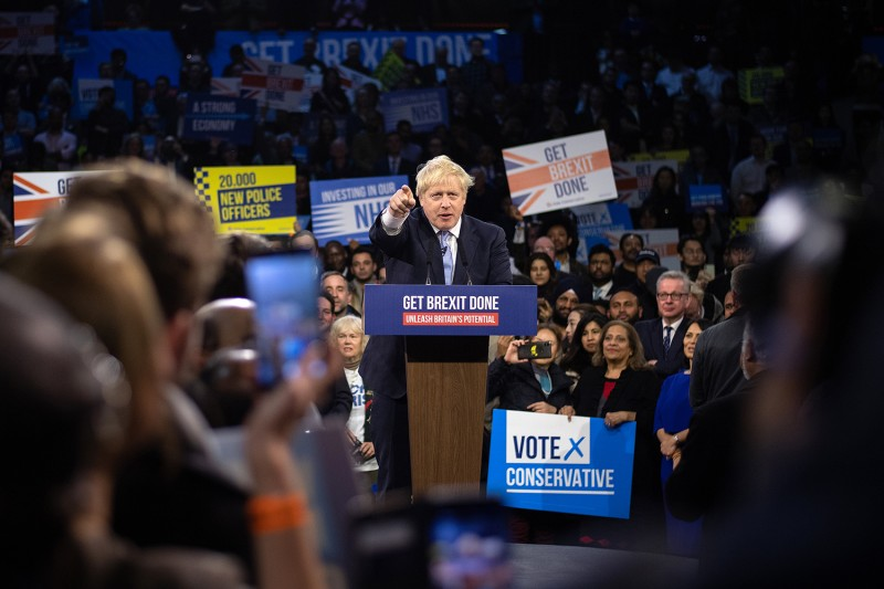 Britain's Prime Minister Boris Johnson speaks to supporters at the Copper Box Arena on Dec. 11 in London.