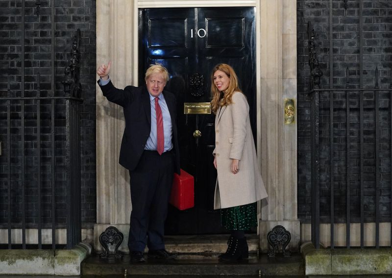 Prime Minister Boris Johnson and his partner Carrie Symonds enter Downing Street as the Conservatives celebrate a sweeping election victory on Dec. 13.