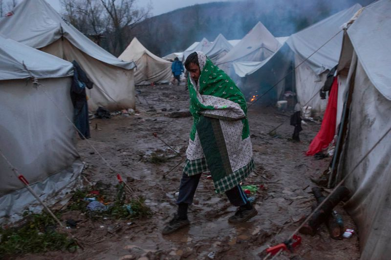 A migrant walks among tents at the Vucjak camp on the outskirts of Bihac in Bosnia and Herzegovinia on  Nov. 20.