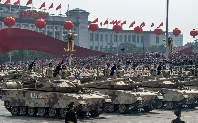 Chinese soldiers sit atop tanks as they drive in a parade to celebrate the 70th Anniversary of the founding of the People's Republic of China.