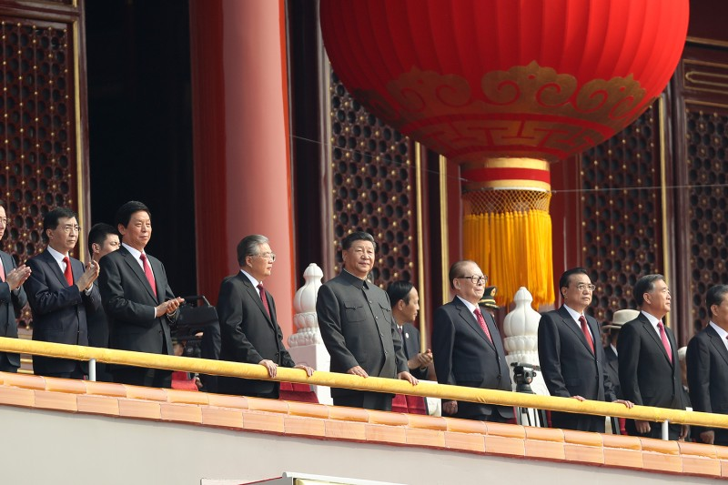 Chinese President Xi Jinping looks over Tiananmen Square