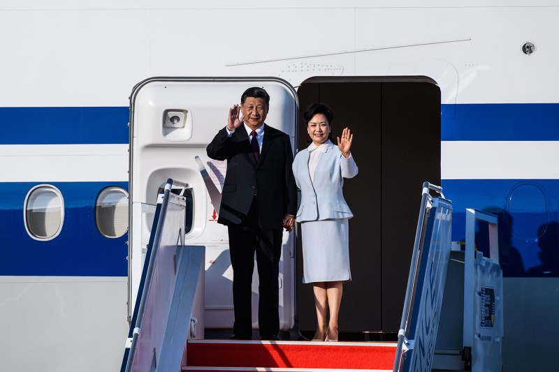 China's President Xi Jinping and his wife, Peng Liyuan, arrive in Macao on Dec. 18.