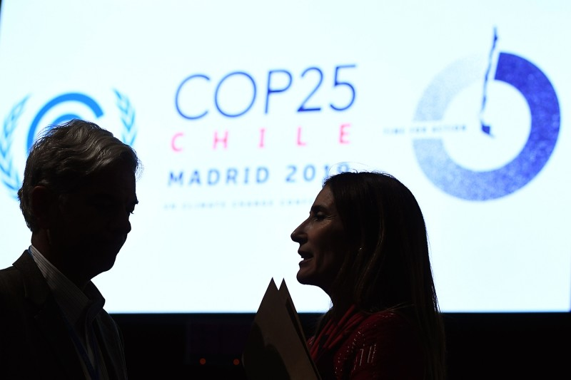 Chile's Minister of Environment and COP25 president Carolina Schmidt talks to Brazilian Secretary for National Sovereignty and Citizenship Fabio Mendes Marzano during the closing session of the U.N. COP 25 climate conference in Madrid on Dec. 15.