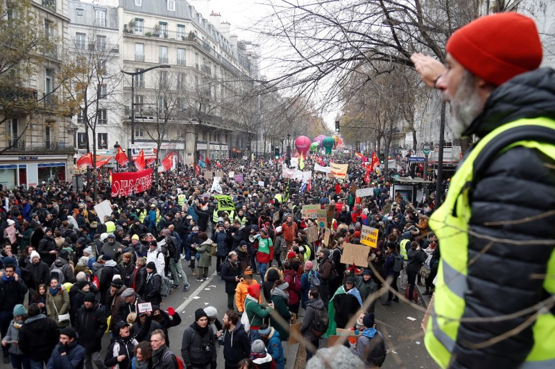 People take part in a demonstration against pension overhauls in Paris on Dec. 5, 2019 as part of a nationwide strike.