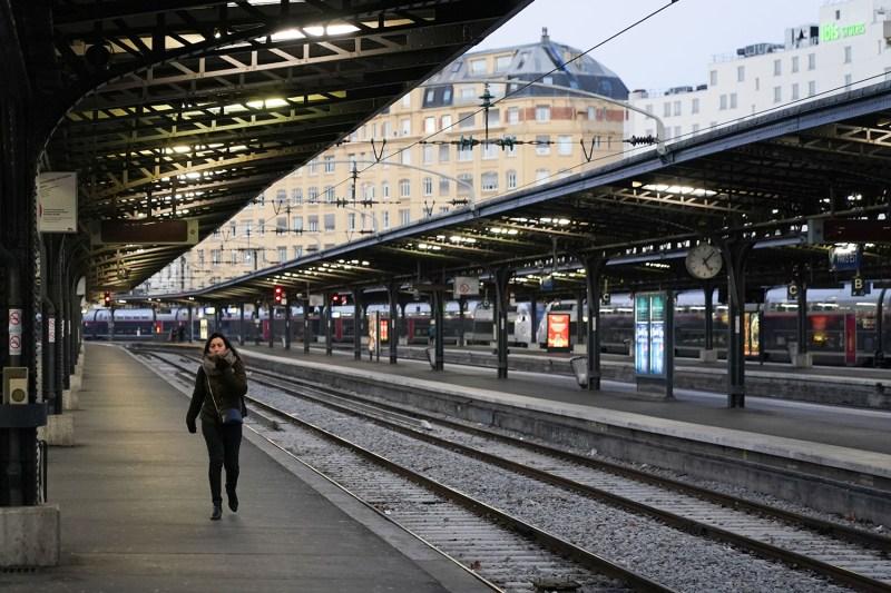 A commuter walks at Gare de L'Est train station in Paris on Dec. 13 during a public transport strike.