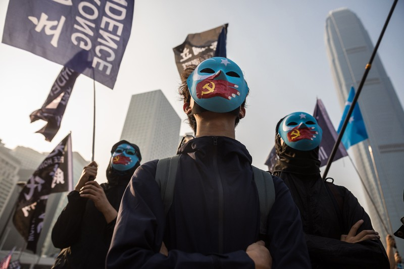 Protesters attend a rally in Hong Kong on Dec. 22 to show support for the Uighur minority in China.