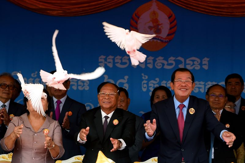 Cambodian Prime Minister Hun Sen and President of the National Assembly Heng Samrin release doves to mark the 68th anniversary of the Cambodian People's Party in Phnom Penh on June 28.
