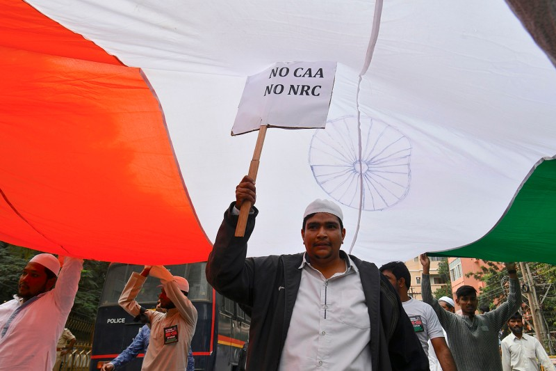 A protester takes part in a rally against India's new citizenship law in Bengaluru on Dec. 23.