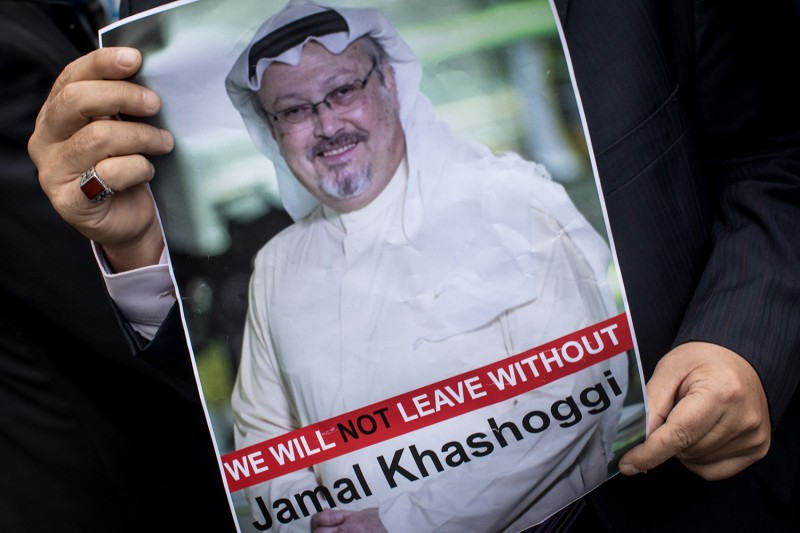 A man holds a poster of Saudi journalist Jamal Khashoggi during a protest at Saudi Arabia's consulate in Istanbul on Oct. 8.