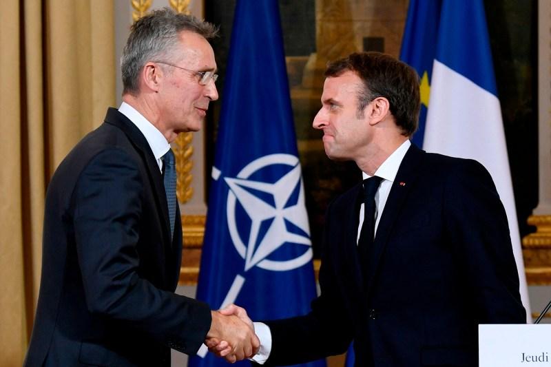 French President Emmanuel Macron and NATO Secretary-General Jens Stoltenberg shake hands after a press conference in Paris on Nov. 28.