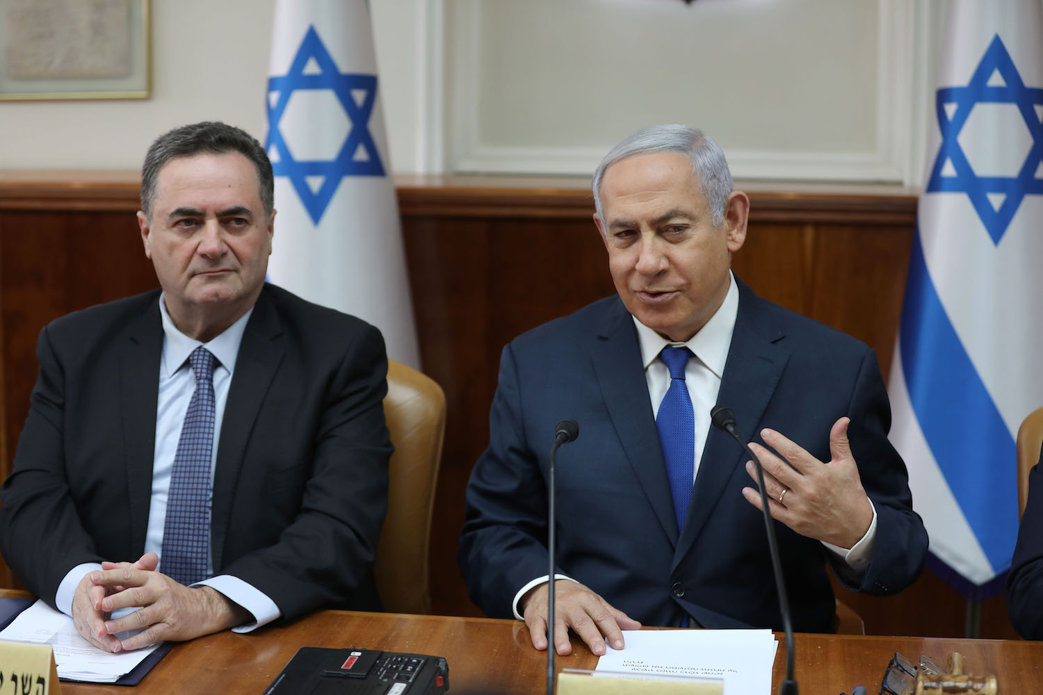 Israeli Prime Minister Benjamin Netanyahu (R) speaks as he sits next to Minister of Foreign Affairs Israel Katz (L) during the weekly cabinet meeting at his office in Jerusalem, on Feb. 24.