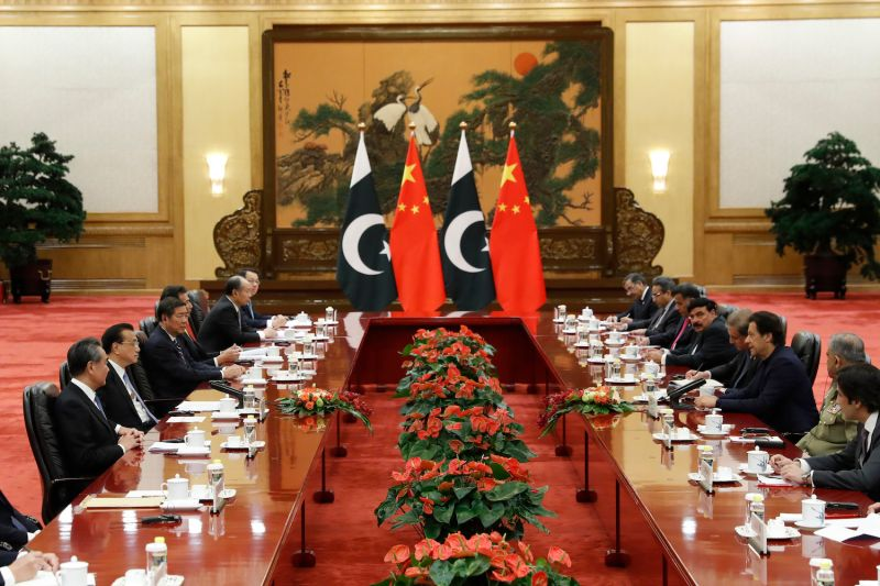 Chinese Premier Li Keqiang (second from left) attends a meeting with Pakistani Prime Minister Imran Khan (third from right) at the Great Hall of the People in Beijing, China.