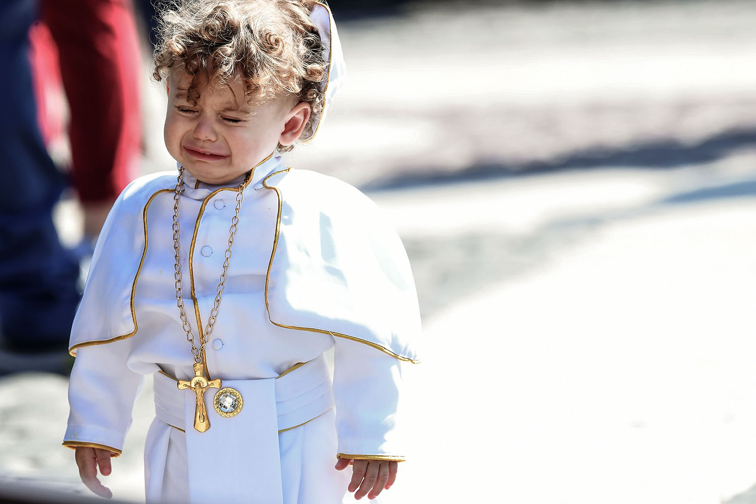 A child dressed as a Pope cries during the weekly Angelus prayer at St. Peter's square in the Vatican on March 3. TIZIANA FABI/AFP/Getty Images