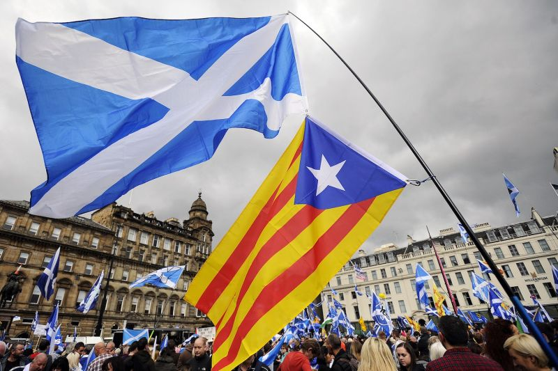 The Scottish Saltire and the flag of Catalonia are pictured as Scottish pro- independence supporters hold a rally in George Square in Glasgow, Scotland, on Sept. 19, 2015.