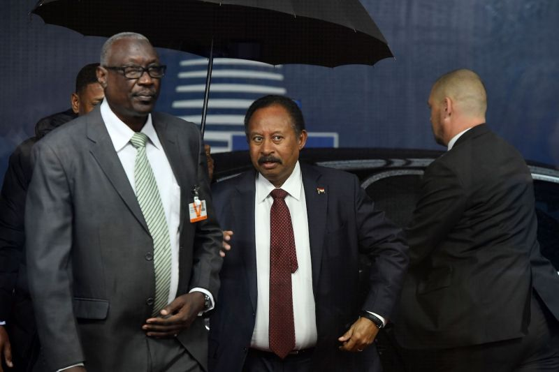 Sudan's Prime Minister Abdalla Hamdok (C) arrives at the EU headquarters in Brussels on Nov. 11.