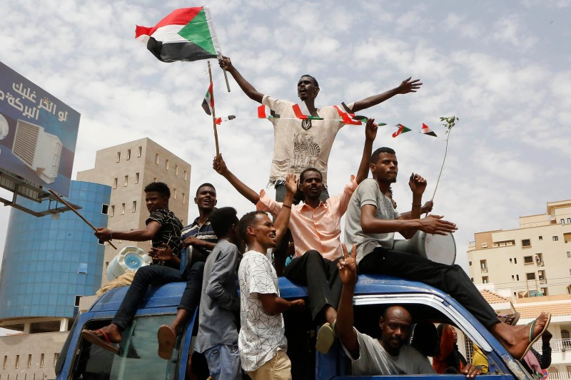 Sudanese people celebrate in the streets of Khartoum on July 5 after ruling generals and protest leaders announced they reached an agreement on the disputed issue of a new governing body.