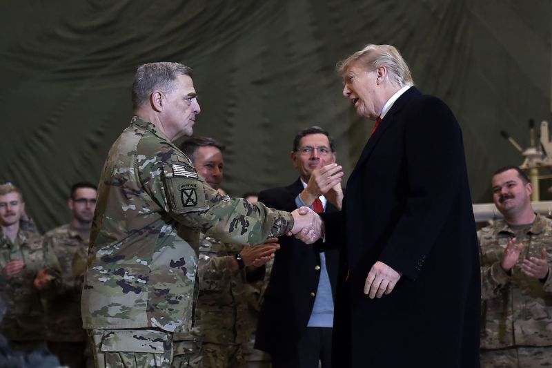 U.S. President Donald Trump shakes hands with Joint Chiefs of Staff Chairman General Mark Milley before addressing troops at Bagram Air Field in Afghanistan during a surprise Thanksgiving Day visit on Nov. 28.