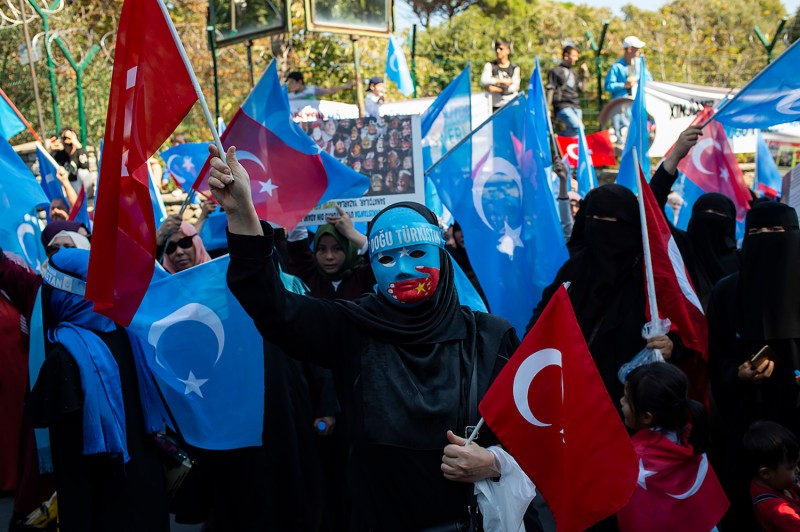 Supporters of China's Muslim Uighur minority and Turkish nationalists wave the flag of East Turkestan during an anti-China protest.
