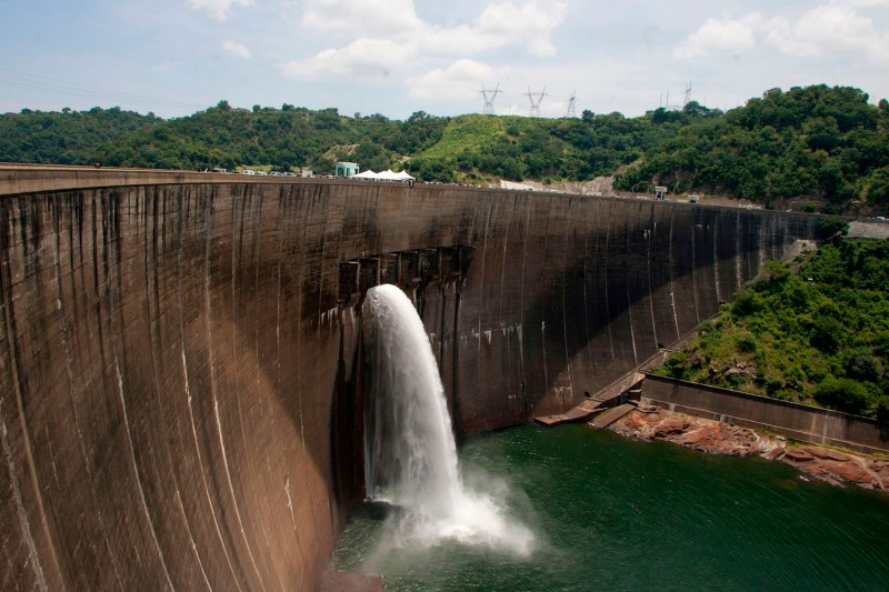 Flood gates on the Kariba Dam wall between Zimbabwe and Zambia open on Feb. 20, 2015 after the two neighbors signed $294 million in deals with international investors. The overhaul project of the world's largest man-made dam will fix deformities and cracks in walls that were discovered in a series of assessments.