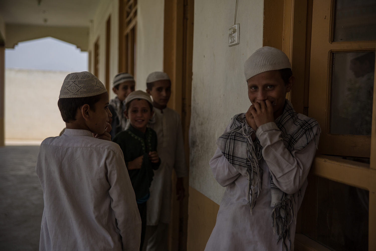 A group of boys gather outside Lamatak's mosque on Sept. 16, 2019.