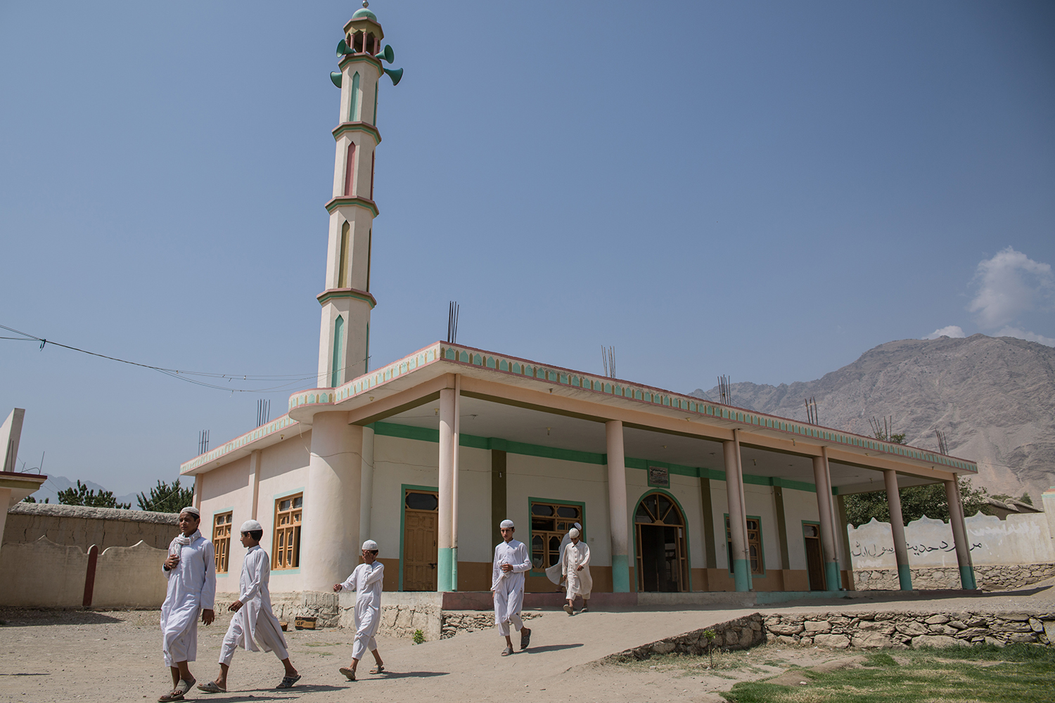 A group of boys stands outside Lamatak's mosque on Sept. 16, 2019.